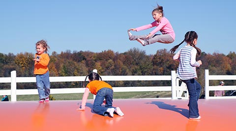Jump pad provides inflatable fall fun for kids.