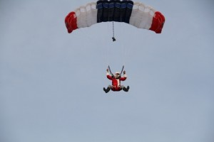 Santa parachutes onto local Saratoga x-mas tree farm