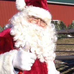 Santa visit's Ellms Family Christmas Tree Farm