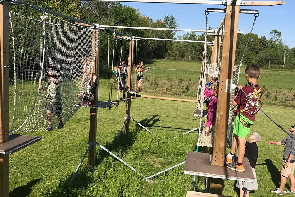 kids doing a ropes course