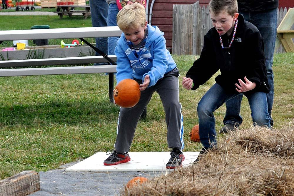 kids bowling for pumpkins
