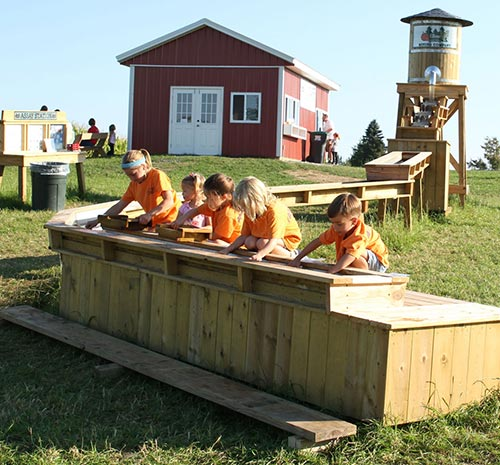 Group of kids at the gem mining activity on Ellms Farm