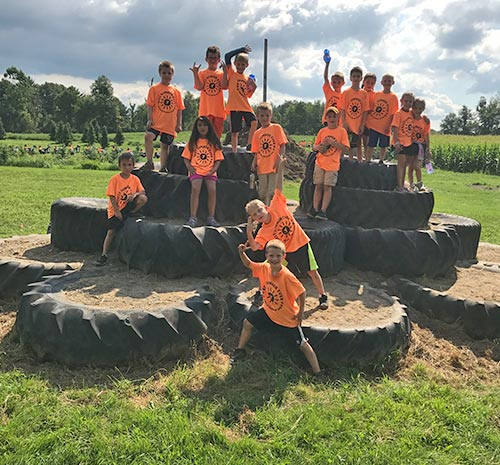 Tire Mountain at Ellms Farm with Children in Orange Shirts - Small