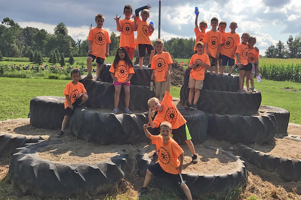 Tire Mountain at Ellms Farm with Children in Orange Shirts - Large
