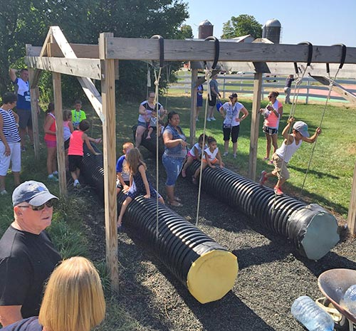 Ellms Farm tube gliders with families playing