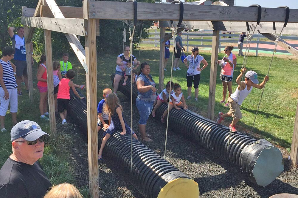 Families playing on the tube gliders at Ellms Farm in Ballston Spa