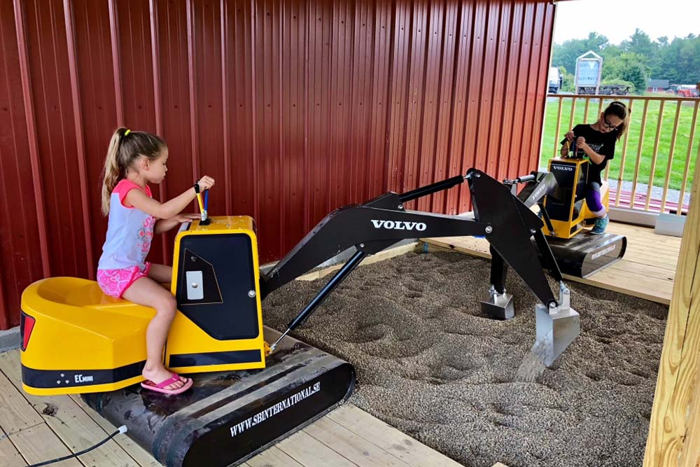 kids driving toy backhoes