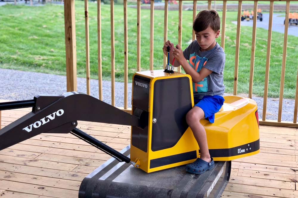boy driving toy backhoe