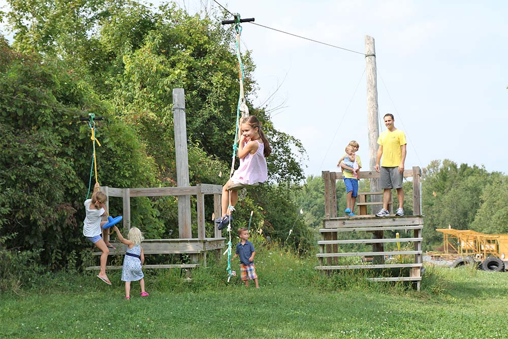 kids riding ziplines