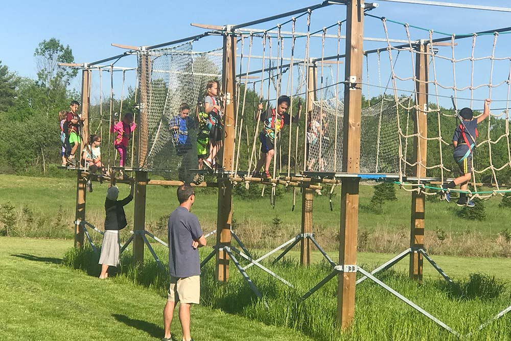 kids on walkways on ropes course