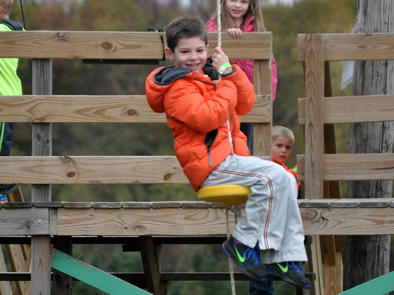 Smiling boy ziplining