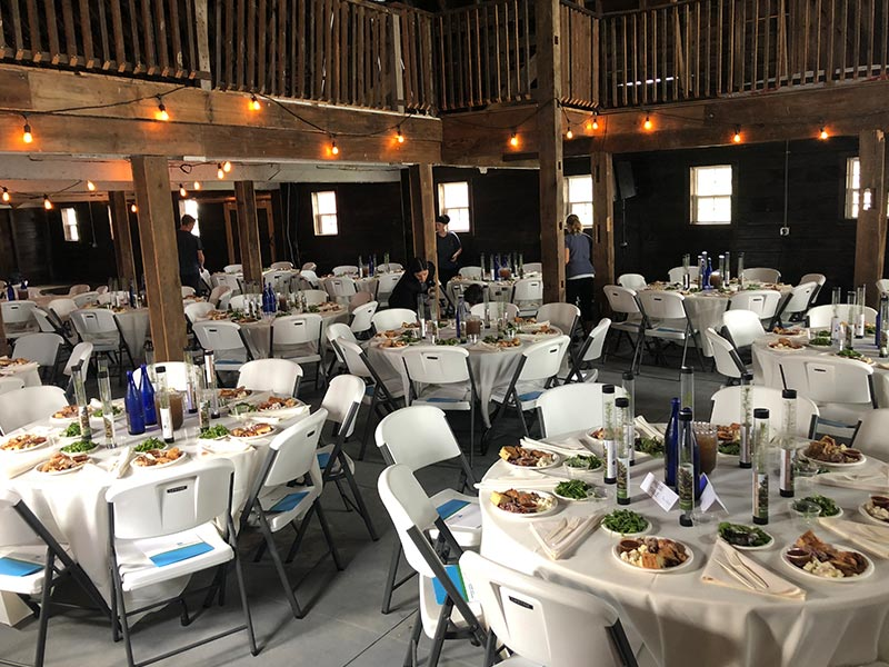 Tables set for a wedding in the barn