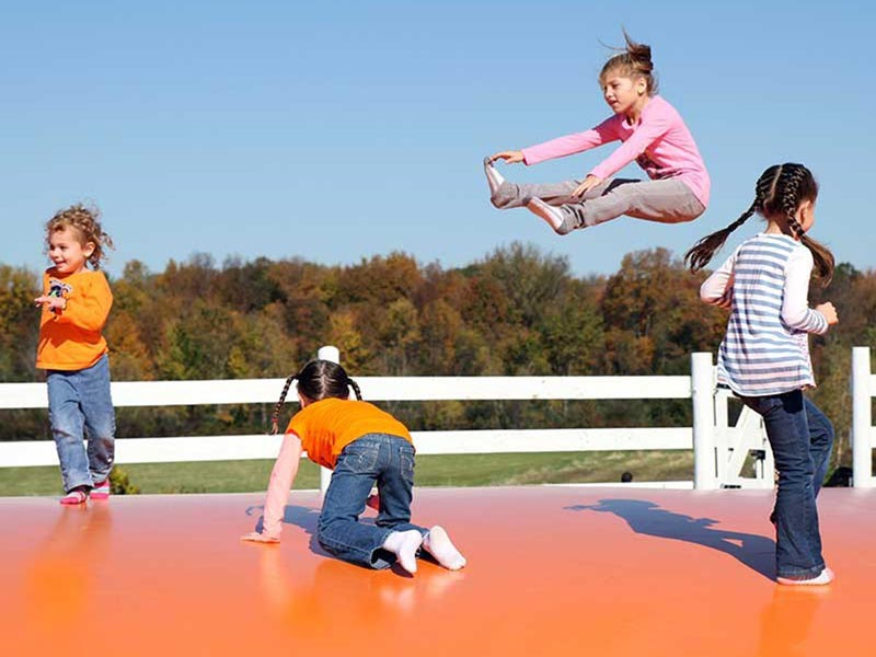 Children playing on the jumping pillow